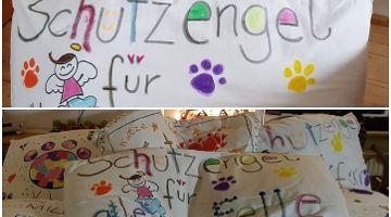 KiTa Nürnberg spendet bemalte Kissen